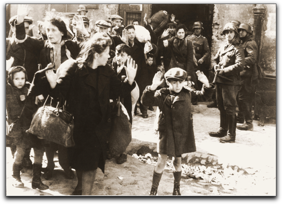the boy with his hands raised being led out of the Warsaw Ghetto